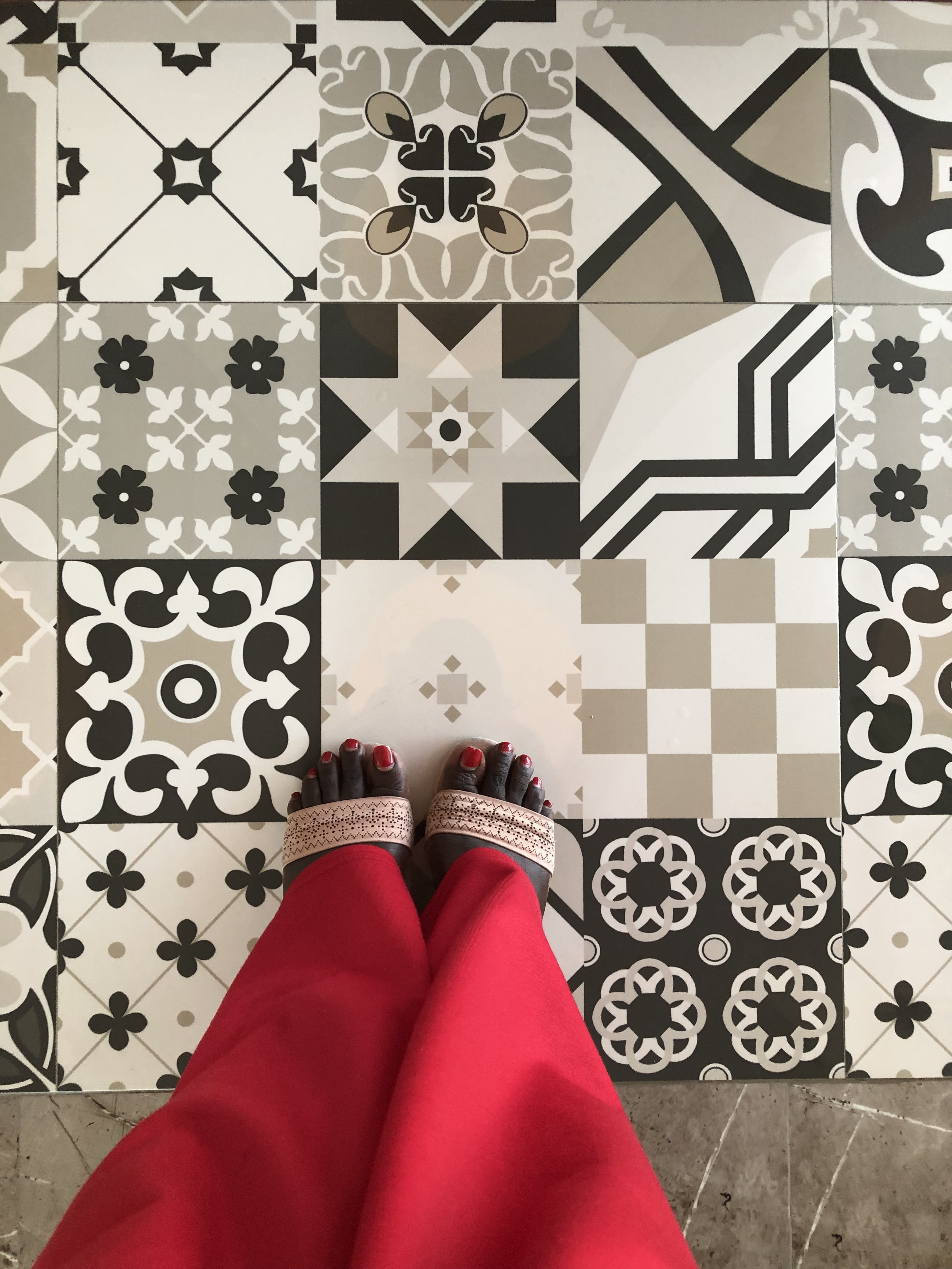 Turkey Tiles and red painted nails